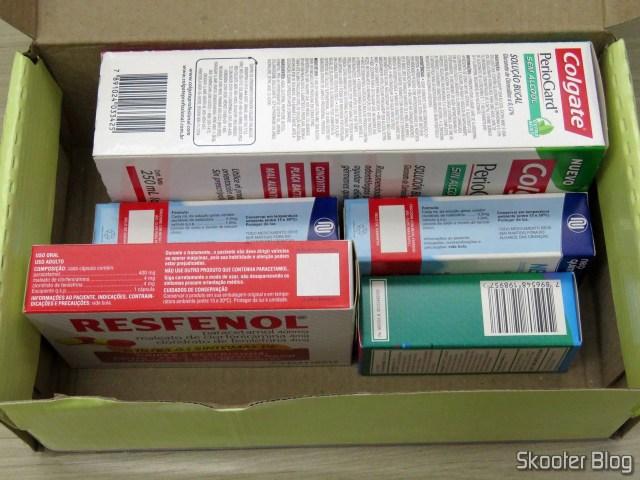 Caixinha da Drogaria Nova Esperança, com Periogard, Systane, Resfenol e 2 Neosoro.