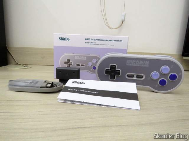 2º 8BitDo SN30 2.4G Wireless Controller for Super Nintendo (SNES) Original, with packaging and accessories.