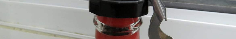Tampa para Garrafas de Vidro na garrafa de Coca-Cola.