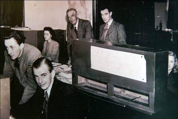 Harold Whitaker at Anson Dyer's studio c.1947, seated bottom right looking at the camera
