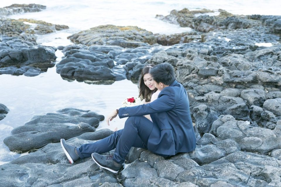 embrace on lava rocks