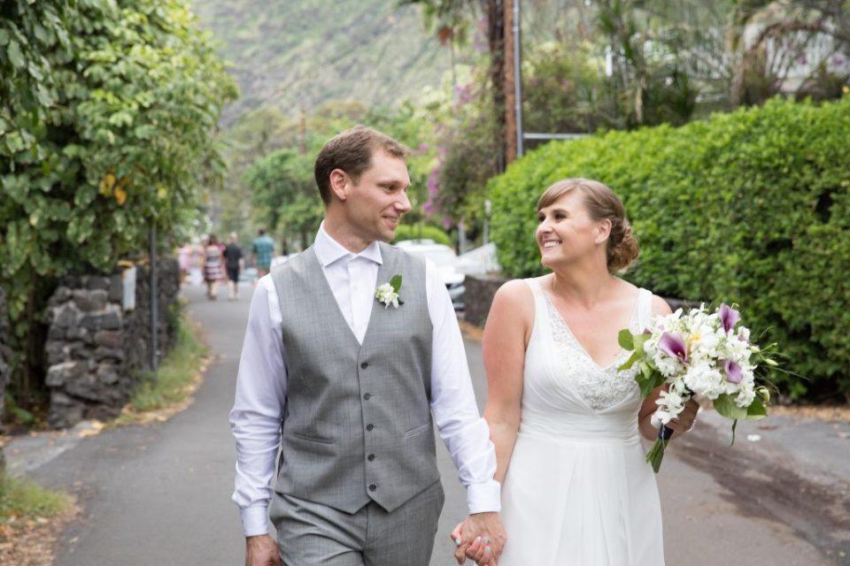 bride and groom walk down street Kealakekua Bay Wedding Venue