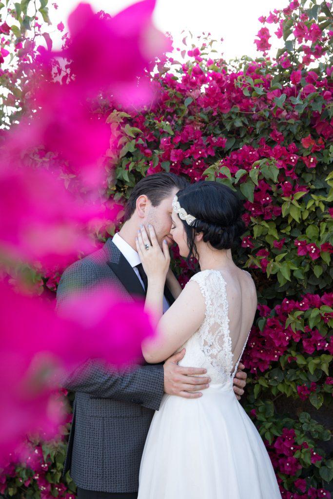 couple kiss outdoors hawaii wedding photographer