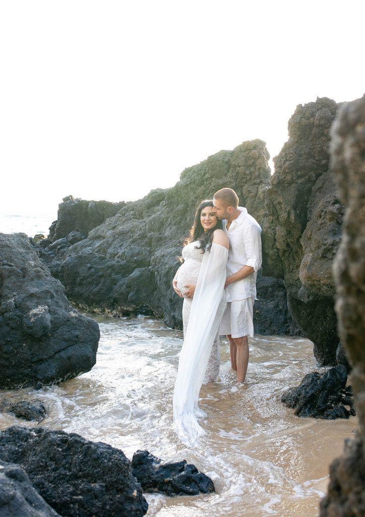 maui maternity couple in rocks beach