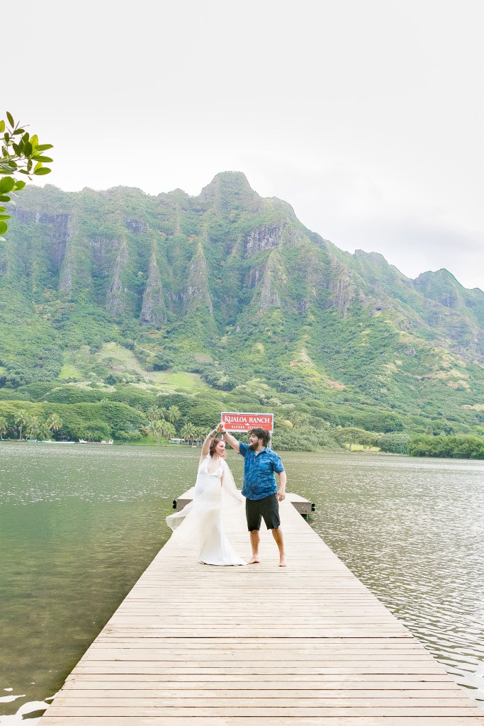 couple dance at pier at secret island Kualoa Ranch Wedding