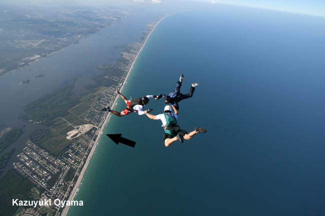 Photo of a 3 way RW Jump during a beach jump