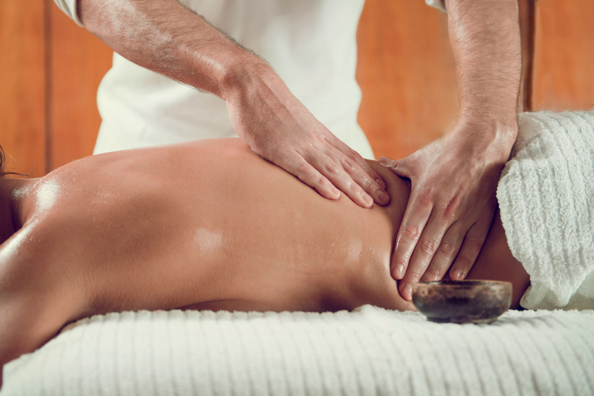 Annoyed By Back Pain? Try Yoga & Massage Before Popping a Pill