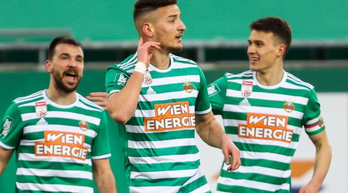 VIENNA,AUSTRIA,14.MAR.21- SOCCER - tipico Bundesliga, SK Rapid Wien vs TSV Hartberg. Image shows the rejoicing of Filip Stojkovic, Ercan Kara and Dejan Ljubicic(Rapid). Photo: GEPA pictures/ Philipp Brem