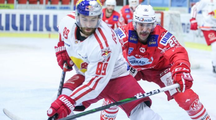 KLAGENFURT,AUSTRIA,28.MAR.21- ICE HOCKEY - Ice Hockey League, play off, semifinal, Klagenfurter AC vs EC Red Bull Salzburg. Image shows Florian Baltram (EC RBS) and Martin Schumnig (KAC). Photo: GEPA pictures/ Daniel Goetzhaber