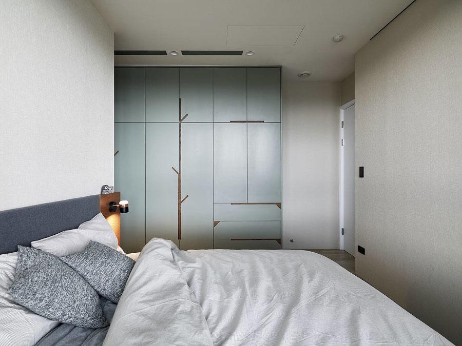 Een strak en modern slaapkamerontwerp met invloed van de