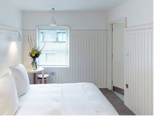 Landelijke slaapkamer van One Leicester Street