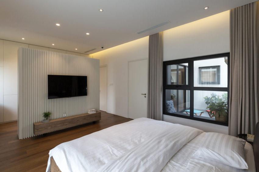 Mooi slaapkamer ontwerp met inloopkast en badkamer en