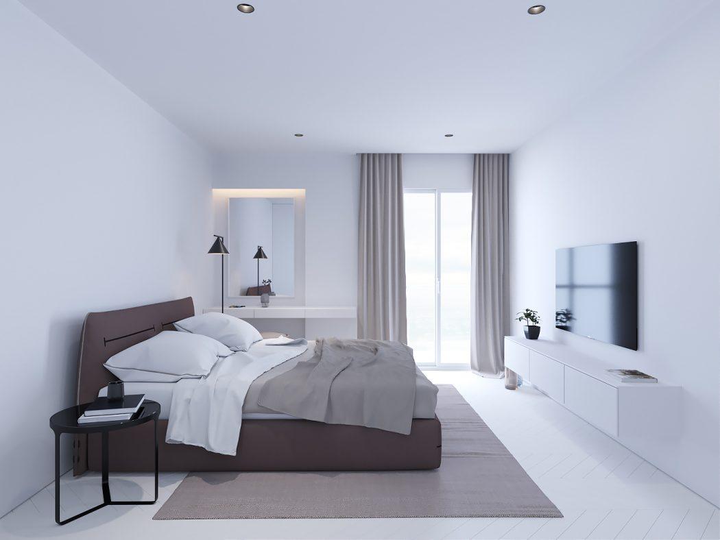 Strakke witte minimalistische slaapkamer met bruin en