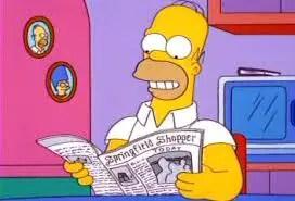 Homer reading newspaper