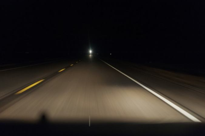 """A Lonely Coast"" involves a dark highway drive along a dark highway such as this"