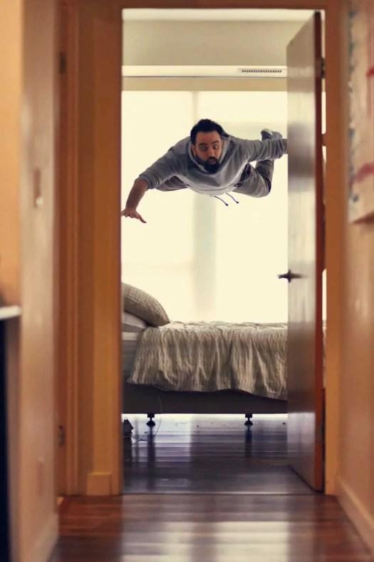 man flies above his bed