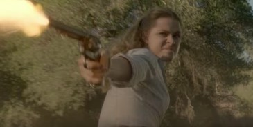 Dolores with a gun on a horse - westworld