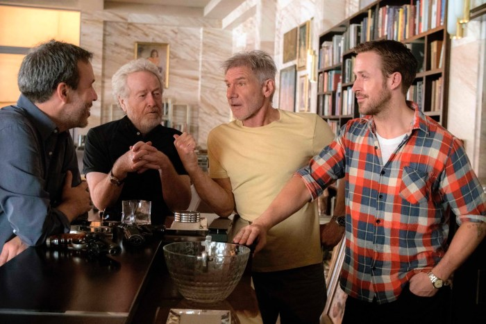 Denis Villeneuve, producer Ridley Scott, and stars Harrison Ford and Ryan Gosling on the set of BLADE RUNNER 2049