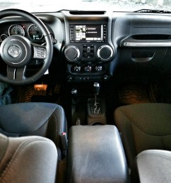 an easy wash fabric hugged the wrangler s five seating positions with decent room front and back for adult riders and although rear visibility is  [ 1080 x 811 Pixel ]