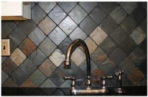 slate backsplash in kitchen faucet handle pros and cons of advantages disadvantages