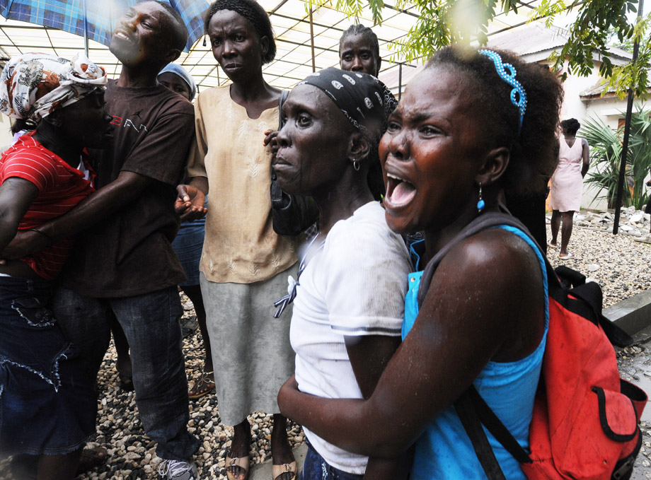 Patients and families wait outside at St. Nicolas Hospital on October 21, 2010 in St. Marc, 96 Km in the north of Port-au-Prince, amid a cholera epidemic.