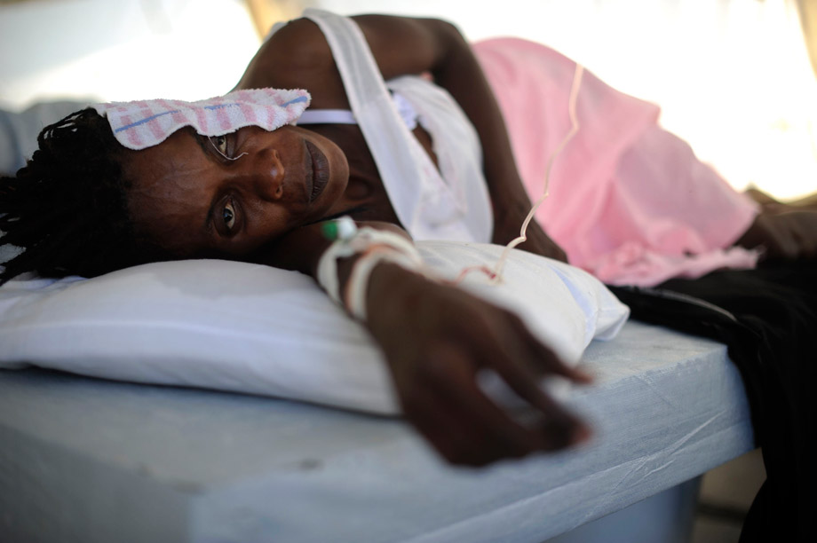A woman infected with cholera receives treatment in a clinic set up by the aid agency Doctors Without Borders, Port-au-Prince, Haiti, Nov. 26, 2010.