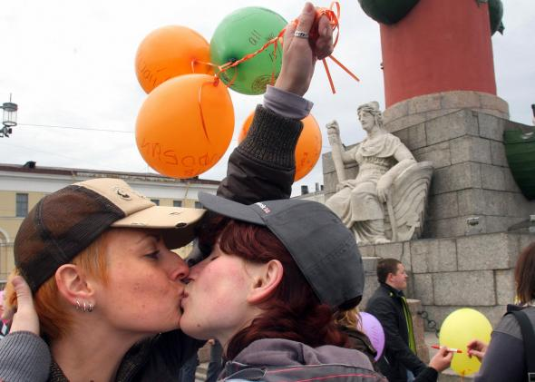 Lesbians kiss during a 2009 gay rights rally in St. Petersburg, Russia.