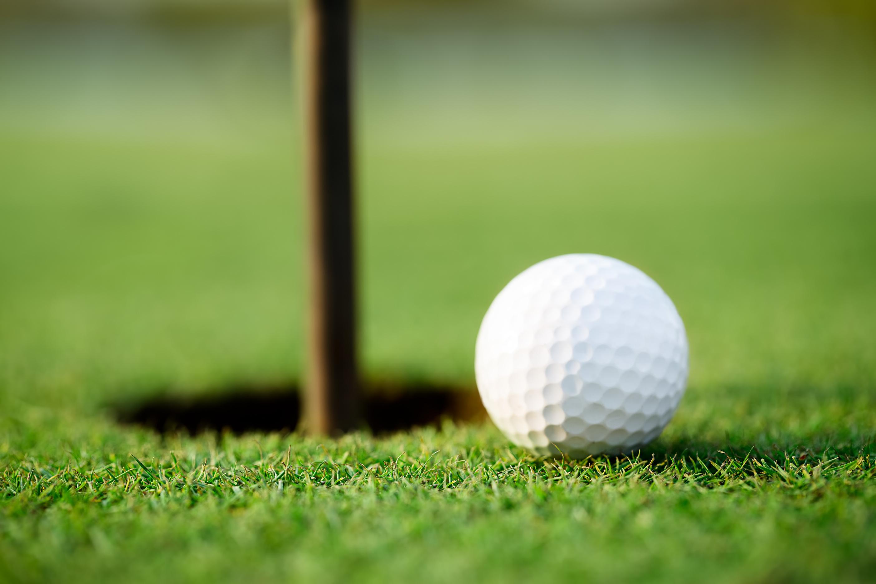 Golf Ball Next To Hole