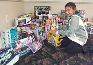 youngest SAM helper, Ariana, to display the over 70 toys donated