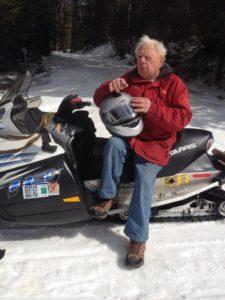 Stan Kopala rides a snowmobile