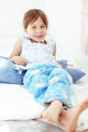 happy child using malem bedwetting alarm