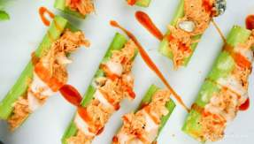 Weight Watchers Buffalo Chicken Celery Bites with ranch dressing and blue cheese.