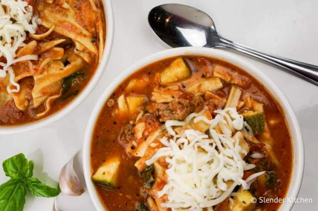 Slow Cooker Lasagna Soup with noodles, zucchini, and beef in a bowl.