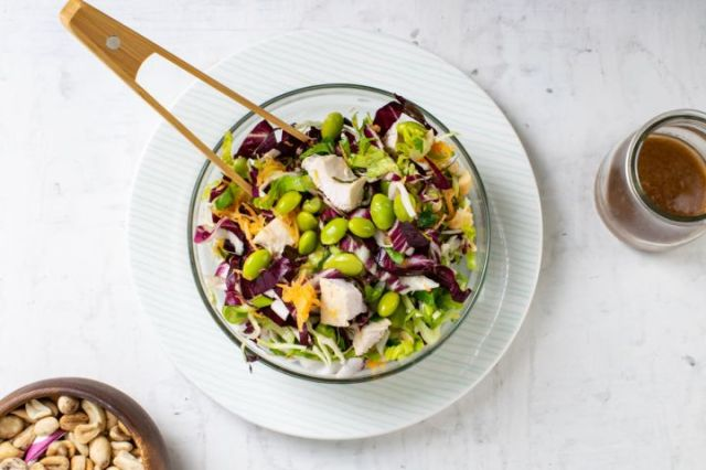 Sweet Chili Chicken Salad with cabbage, edamame, and a peanut lime dressing.