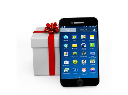 Mobile Phone With Gift Box Showing Phone As Gift Stock Photo PowerPoint Shapes PowerPoint