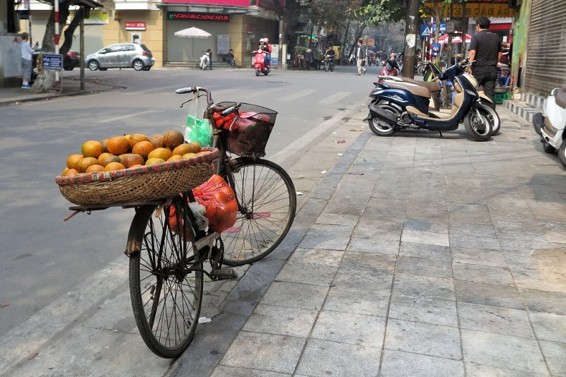 a bike carrying oranges