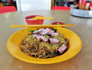 Week 48: Singapore - ultimately, this simple hawker dish of crispy pork over yellow noodles was one of our favorites!