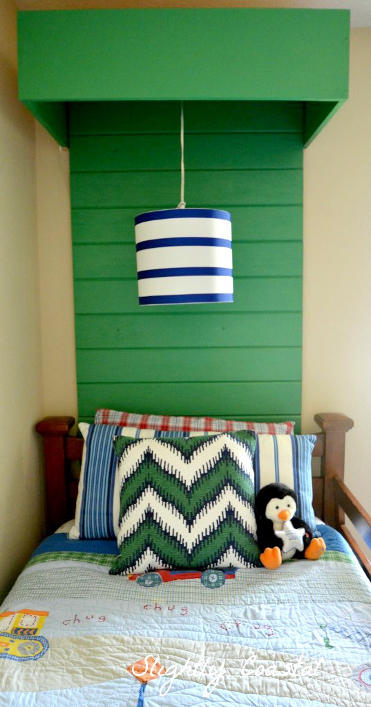 Hanging Light in Front of Planked Headboard