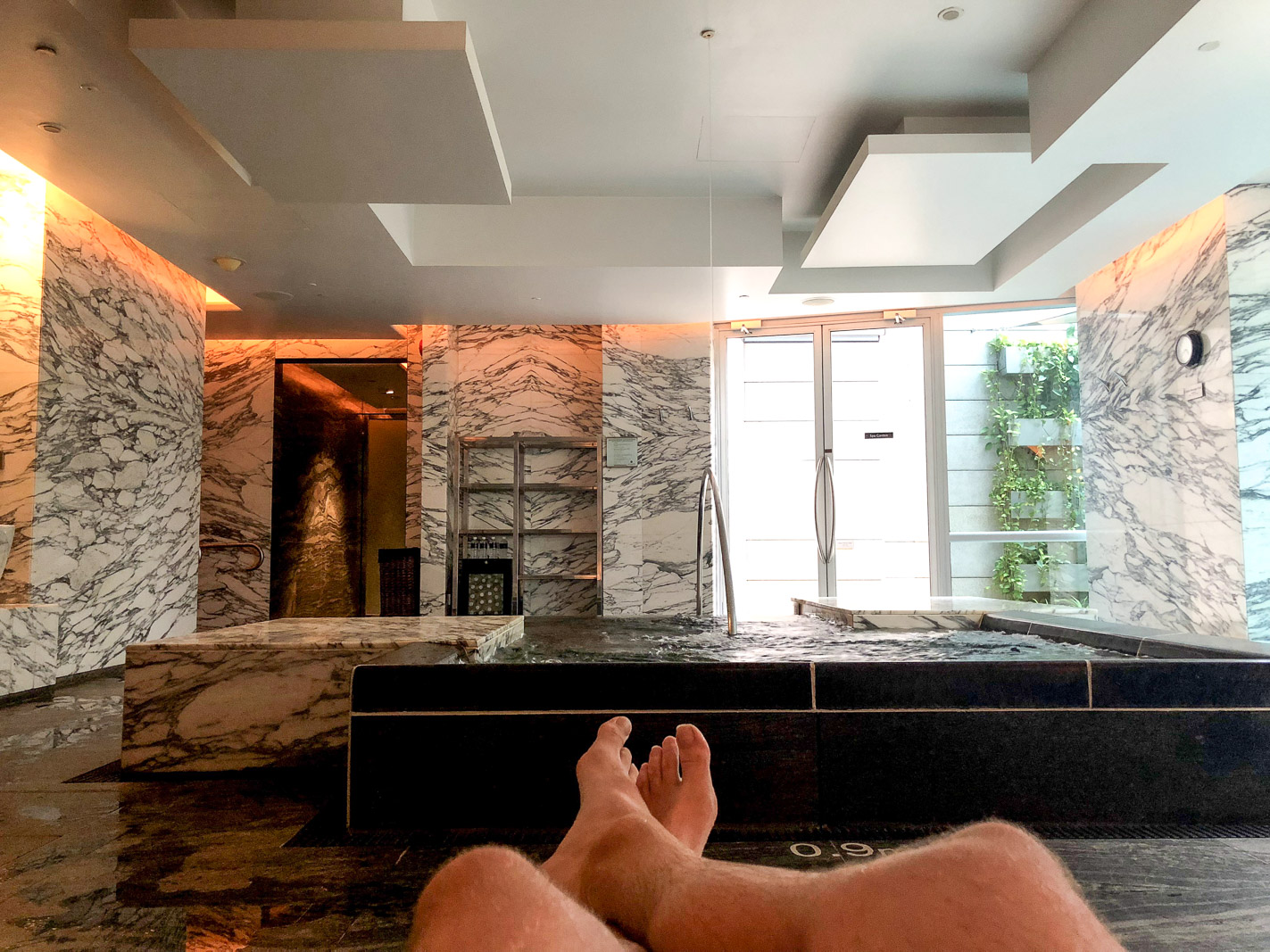 laying down at the St. Regis Singapore Spa
