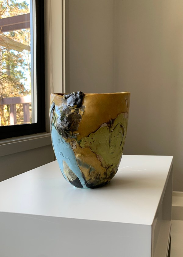 handbuilt pottery vase with yellow lilies