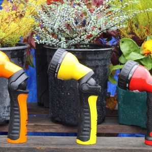 Colorful Dramm hose nozzles help you water