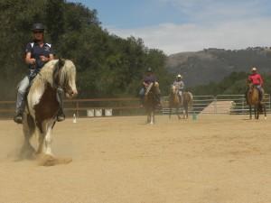Riders try shoulder in down cenerline
