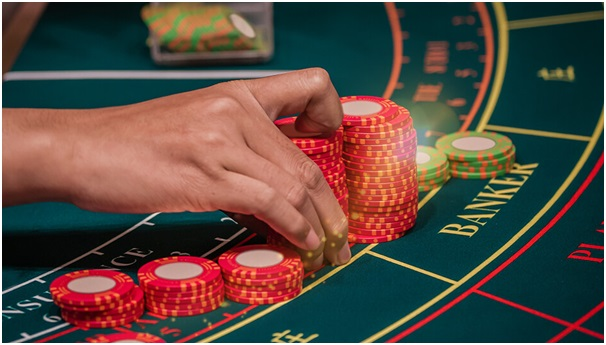 Baccarat with high paying tie bets