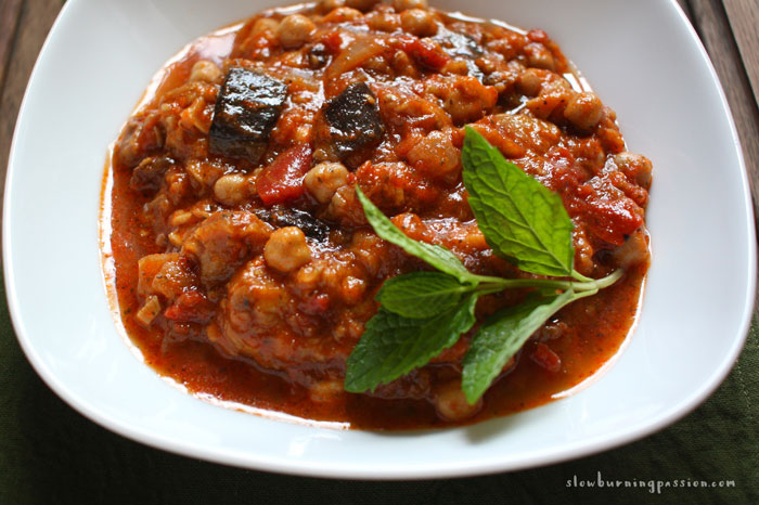 Image result for greek eggplant-based, casserole-style dish, layered with tomatoes, peppers, onions and other veggies