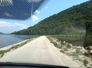 Road to Braca - Note the water on either side
