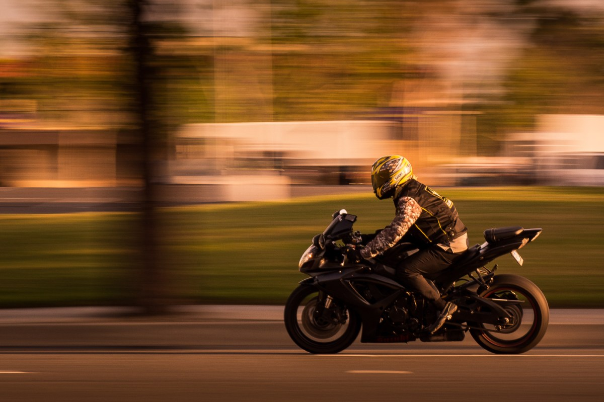 How to Hold a Camera and Panning Tutorial - SLR Lounge