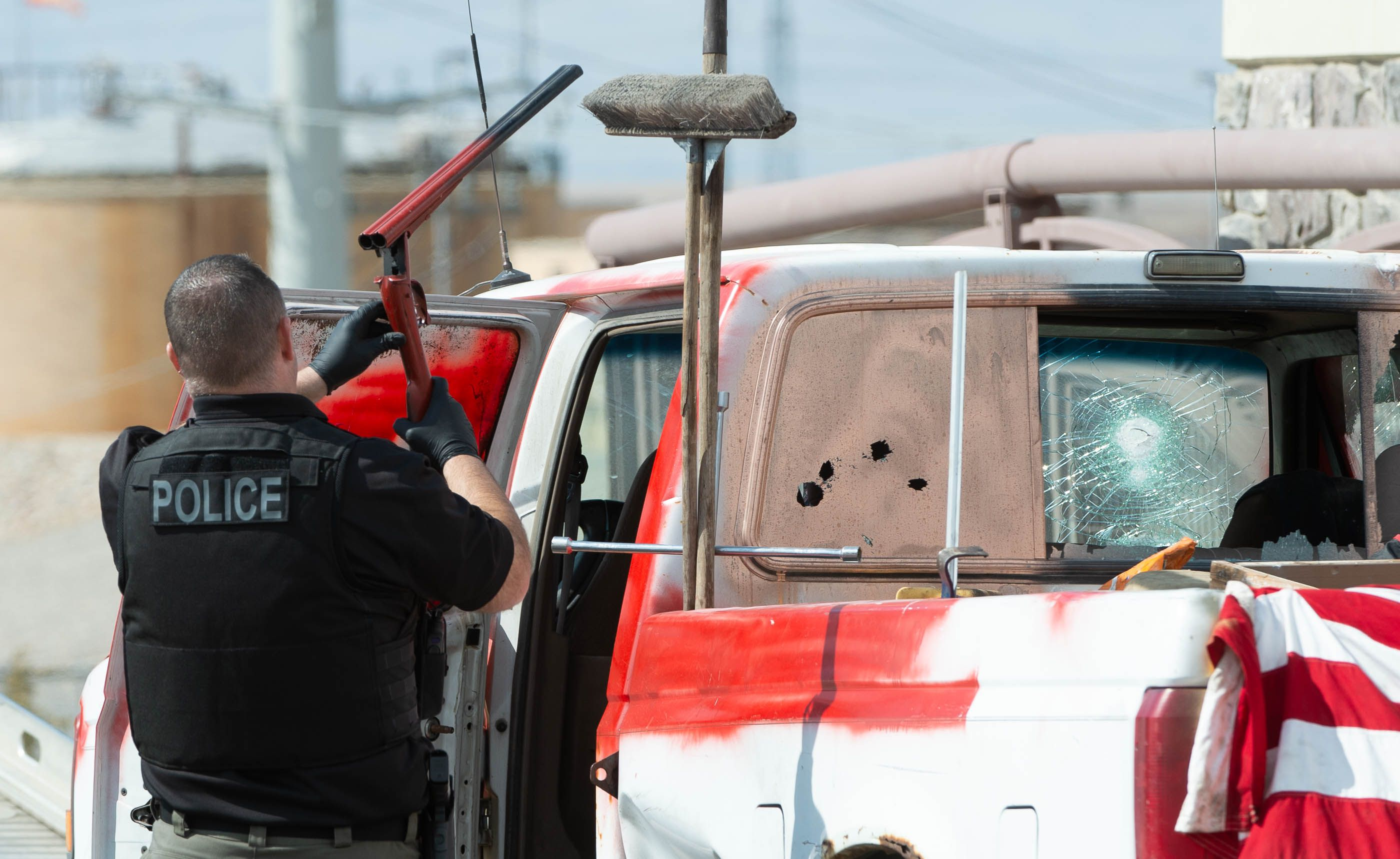 (Francisco Kjolseth  | The Salt Lake Tribune) Investigators remove a double barrel shotgun from a vehicle as numerous police agencies respond to a man driving erratically and claiming to have a gun and a bomb with an initial police chase ending on Center Street over Legacy Highway on Wednesday, March 17, 2021. The suspect was taken into custody.