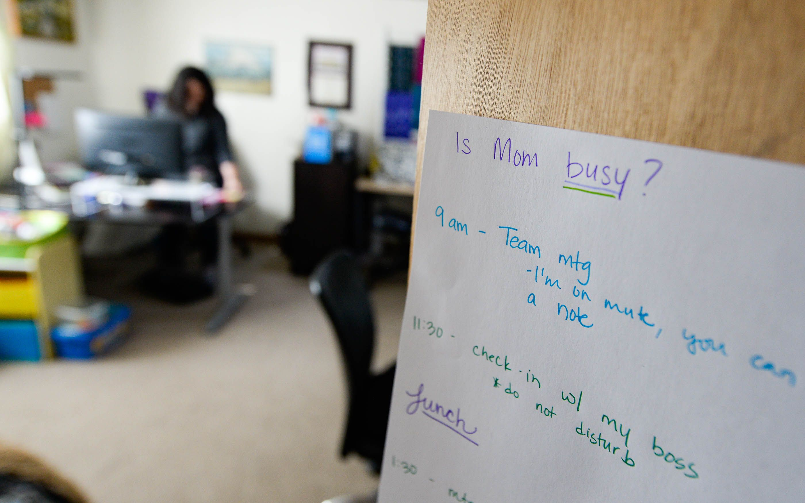 (Francisco Kjolseth  | The Salt Lake Tribune) Jessica Dalton, Assoc. Director of Annual Giving at Westminster College who has transitioned to full-time at work-from-home where her slippers are consistently part of her daily wardrobe, posts a schedule of her Zoom meetings on the door to her office to let her family know when she is off limits.