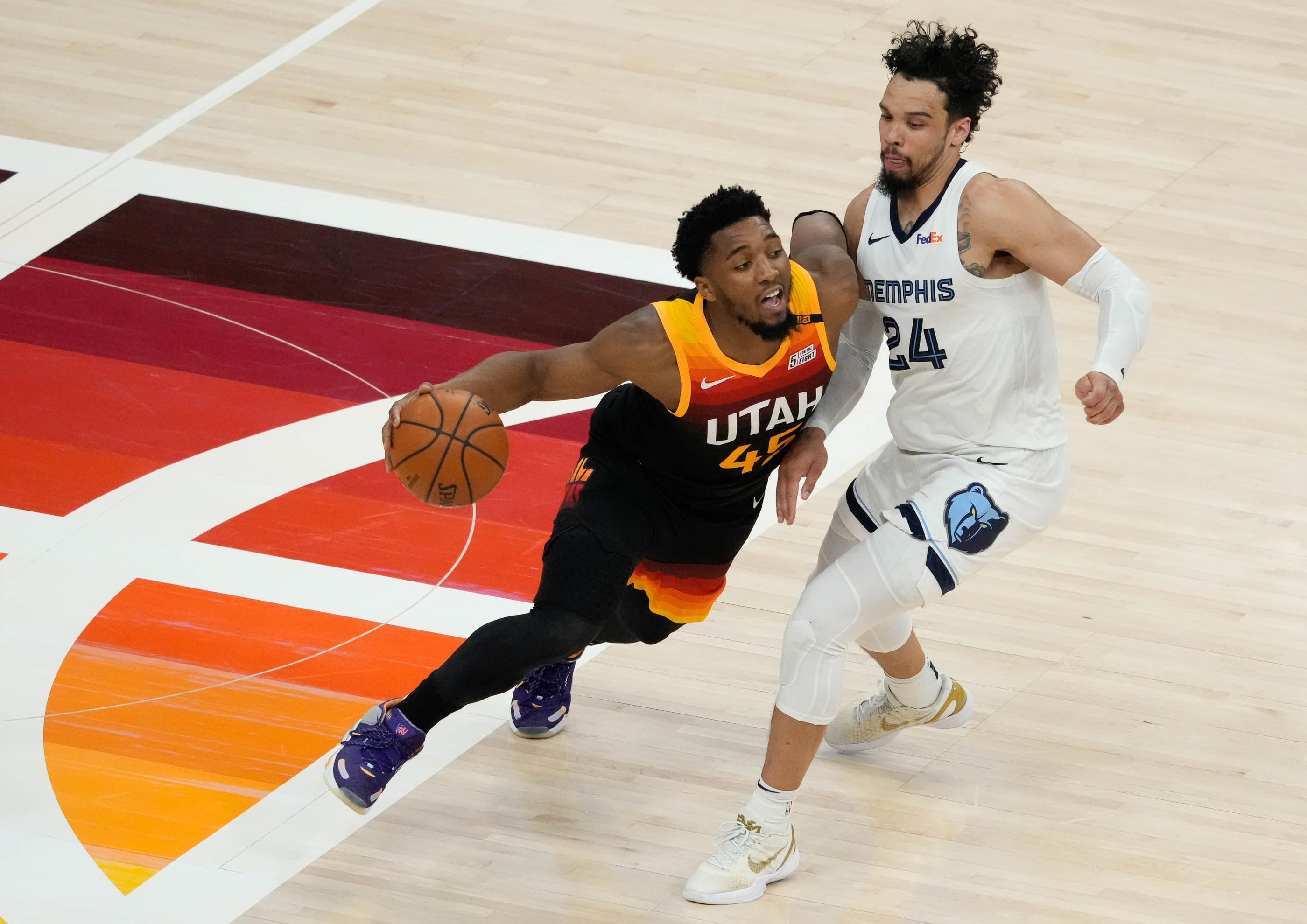 (Francisco Kjolseth | The Salt Lake Tribune) Utah Jazz guard Donovan Mitchell (45) pushes past Memphis Grizzlies forward Dillon Brooks (24) in the second half of Game 5 of an NBA basketball first-round playoff series Wednesday, June 2, 2021, in Salt Lake City, UT.