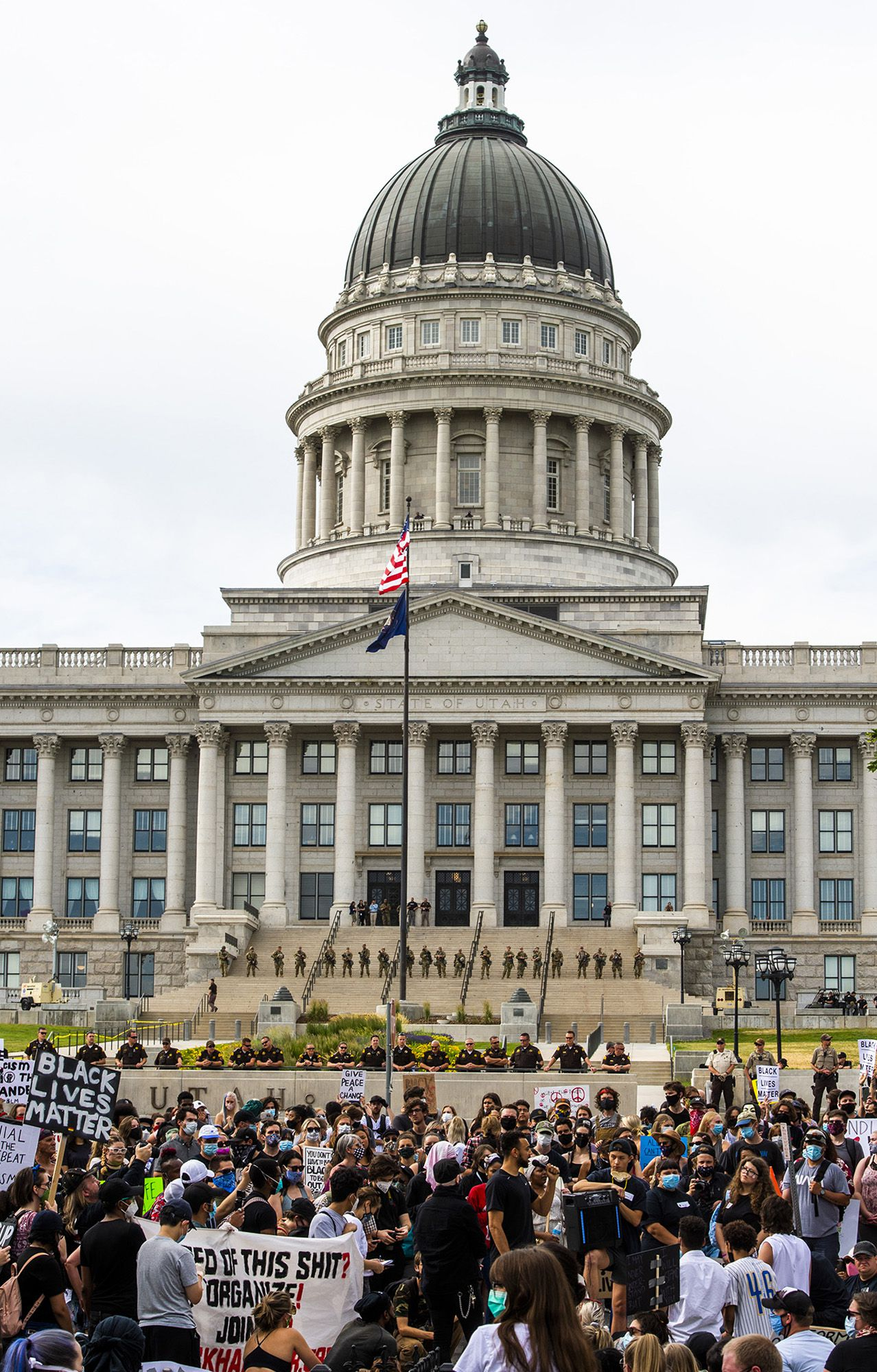 (Rick Egan  |  The Salt Lake Tribune) Police observe the protest from across the street on the grounds of the Sate Capitol, during a George Floyd demonstration in Salt Lake City on Thursday, June 4, 2020.